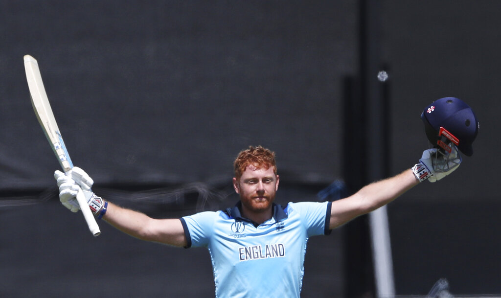 England's Jonny Bairstow celebrates after scoring a century during the Cricket World Cup match between New Zealand and England in Chester-le-Street, England, Wednesday, July 3, 2019.