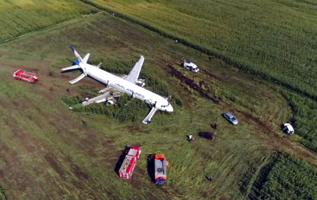 In this video grab provided by the RU-RTR Russian television, a Russian Ural Airlines' A321 plane is seen after an emergency landing in a cornfield near Ramenskoye, outside Moscow, Russia, Aug. 15, 2019.