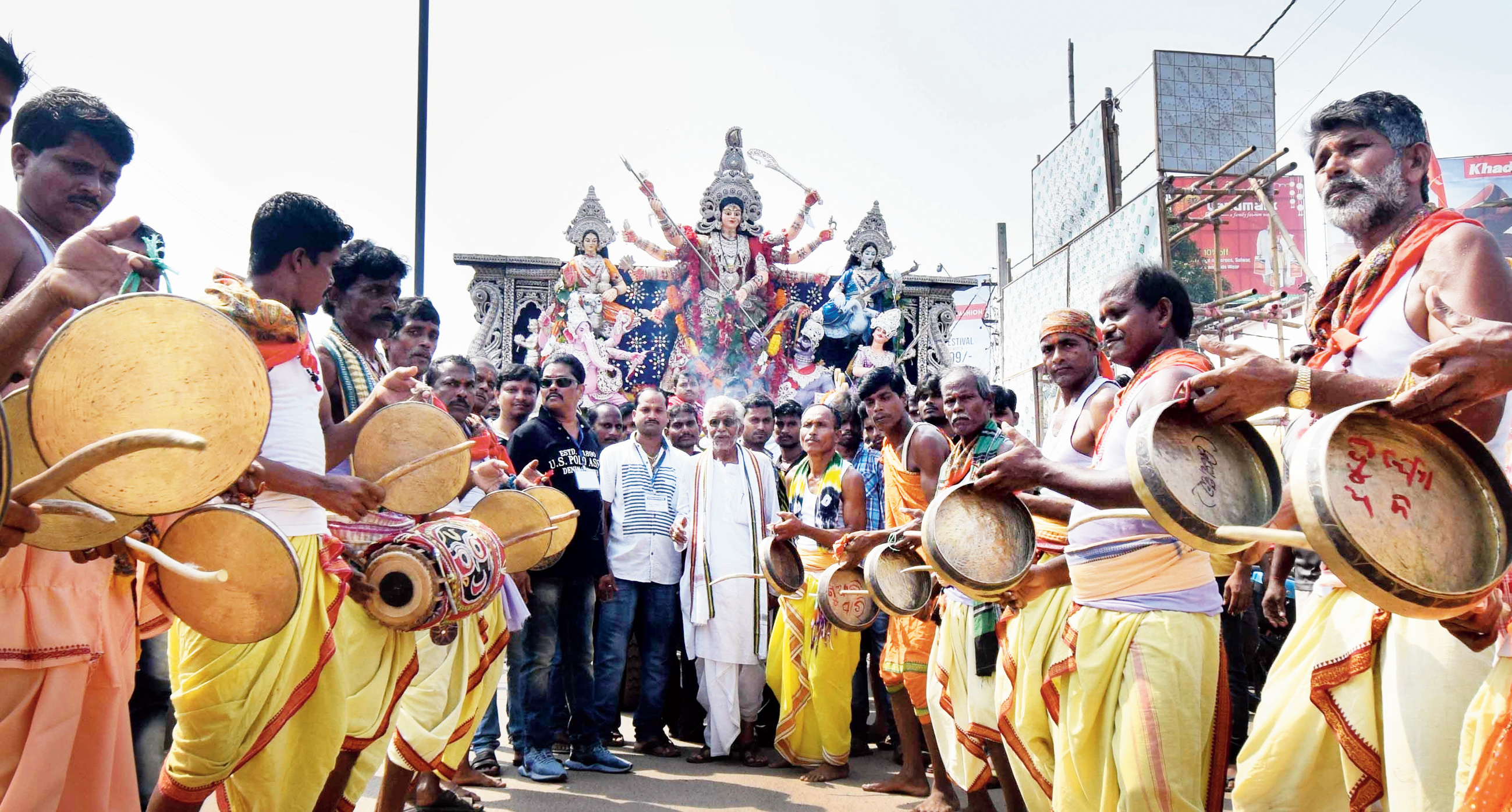 Devotional fervour: Traditional musicians accompany an immersion procession in Cuttack on Saturday.