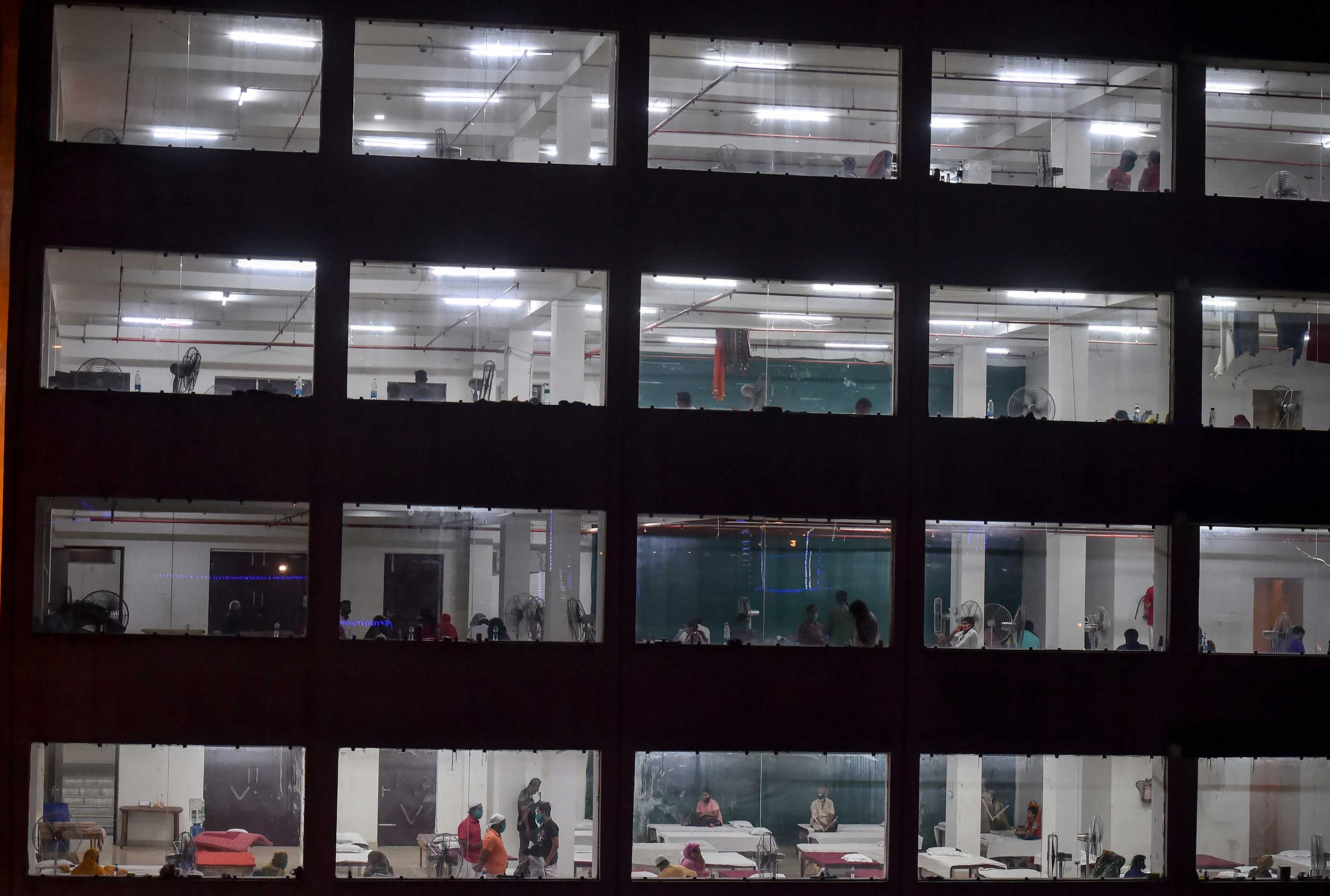 Patients receive treatment at a quarantine centre during the nationwide lockdown in Calcutta.