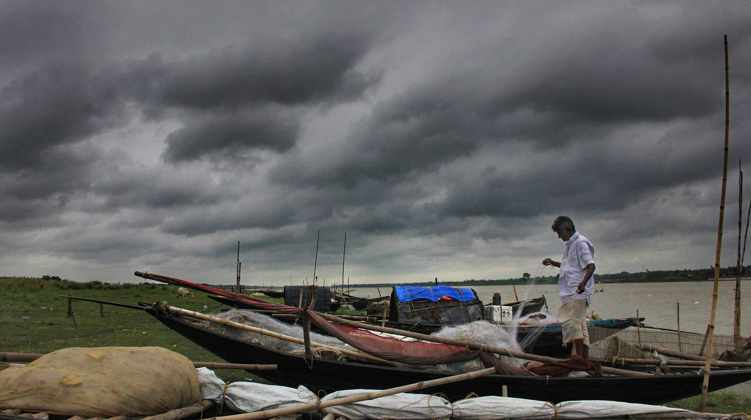 A fisherman arranges his fishing net before venturing out into the sea, after Cyclone Fani made landfall, in Nadia, on May 4, 2019. People of West Bengal heaved a sigh of relief as Fani weakened on Saturday morning and was moving towards Bangladesh.