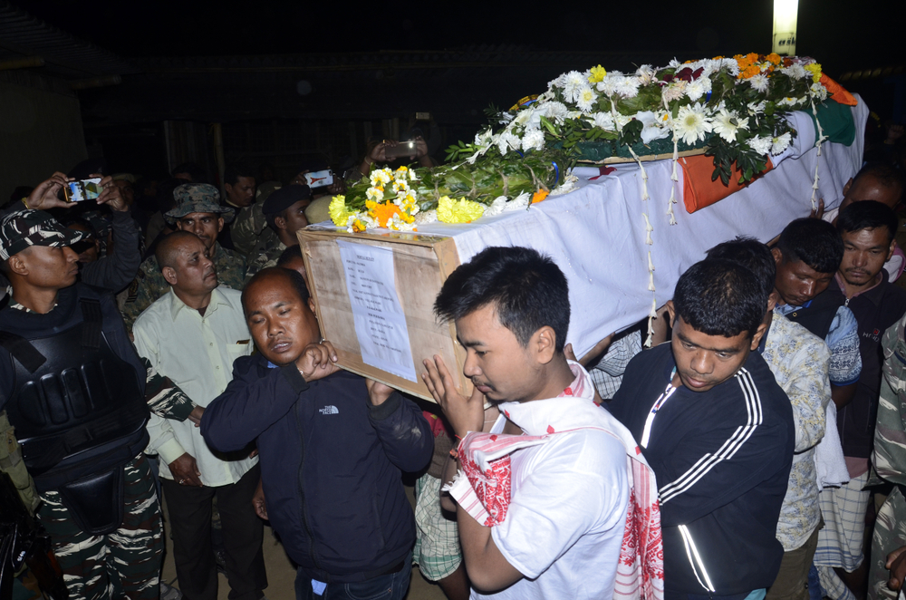 Dhananjay Basumatary (in white) carries the coffin of his father, 48-year-old Maneshwar Basumatary of the CRPF who died in Pulwama, at the funeral in Assam on February 16, 2019