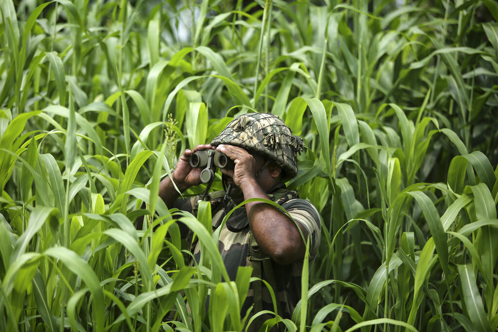 A Border Security Force (BSF) soldier keeps vigil near the India Pakistan border at Garkhal in Akhnoor, about 35 kilometers (22 miles) west of Jammu, August 13, 2019. The image was part of the series which won the 2020 Pulitzer Prize for Feature Photography.