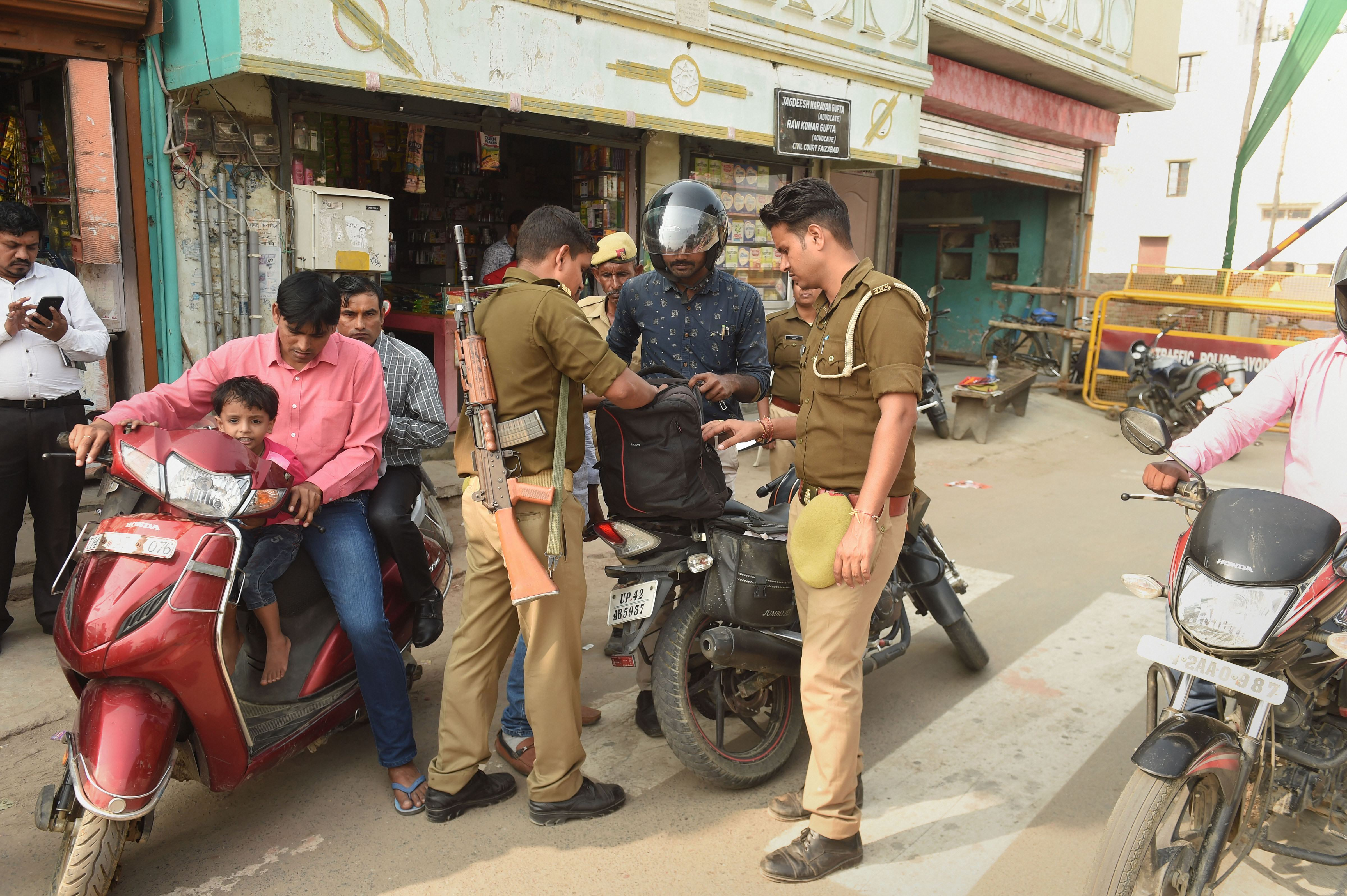 Police personnel conduct searches near the disputed Ram Janambhoomi-Babri Masjid site on November 8.