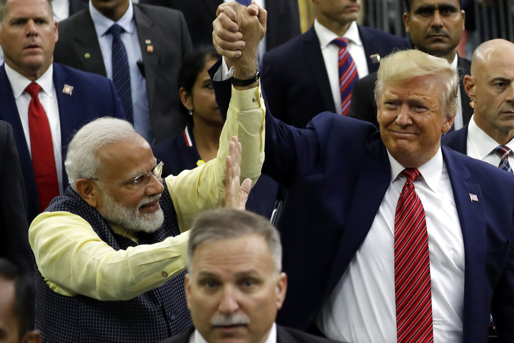 US President Donald Trump and Indian Prime Minister Narendra Modi walk around NRG Stadium waving to the crowd during the