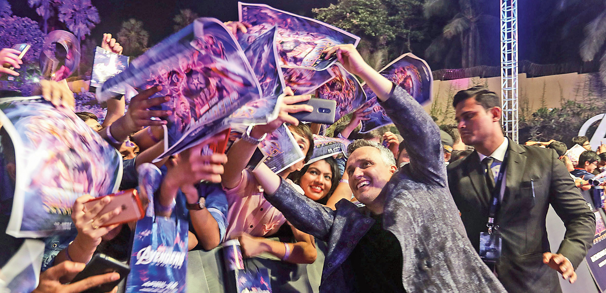 Joe Russo takes selfies with fans in Mumbai on April 1