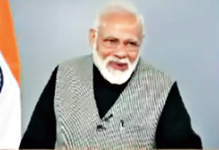 Modi interrupts the student, utters what he appears to think is a joke and makes a wry face.