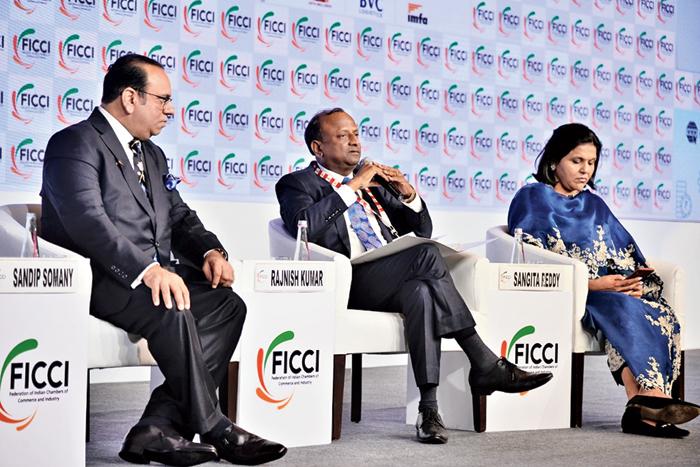 Sandip Somany, Rajnish Kumar and Sangita Reddy at the Ficci convention in New Delhi on Saturday