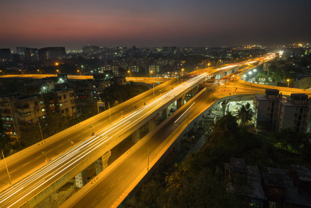 Night view of Santacruz-Chembur Link Road in Mumbai. A major impact of the reforms of the 1990s was the opening up of the economy, which took work to ports and airports. The cities were where people got better jobs and earned more. But in villages there was no such impact.