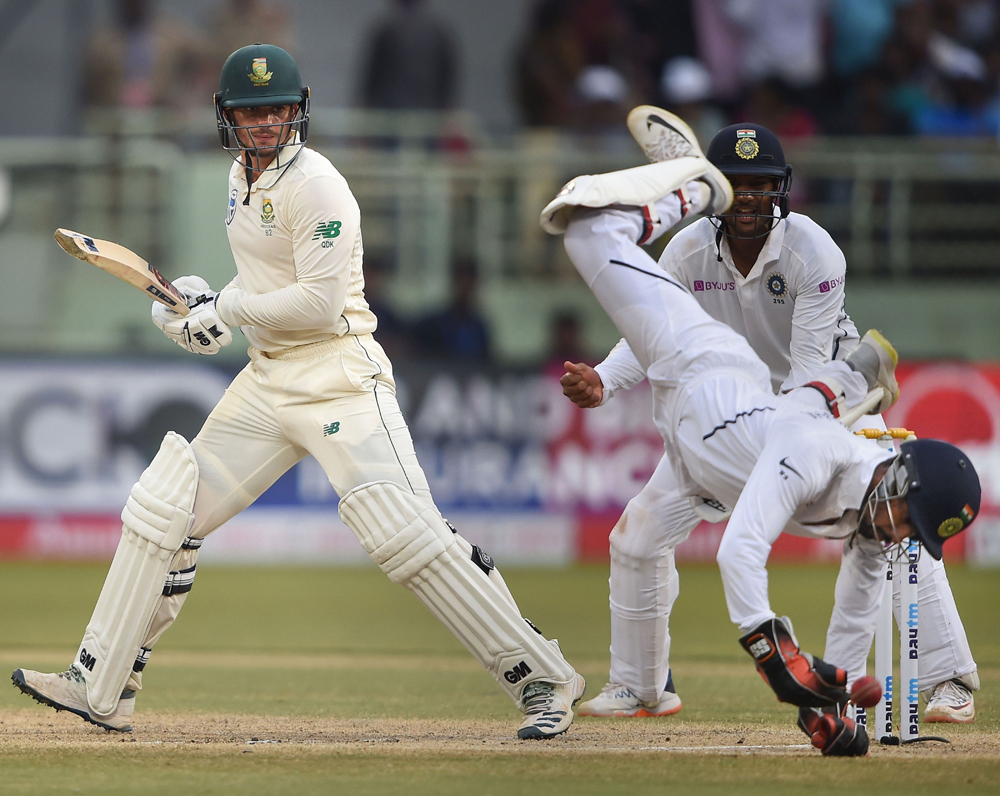 Wriddhiman Saha tries to dismiss South Africa's Quinton de Kock on the third day of the first Test in Visakhapatnam on Friday