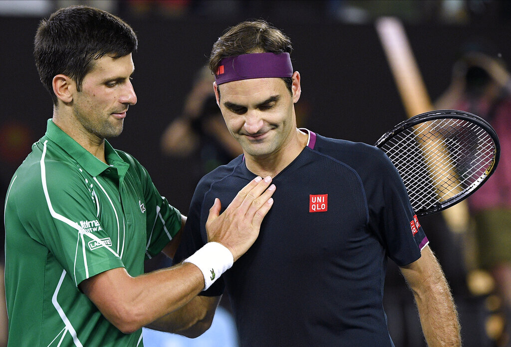 Switzerland's Roger Federer, right, congratulates Serbia's Novak Djokovic on winning their semifinal match at the Australian Open tennis championship in Melbourne, Australia, on Thursday