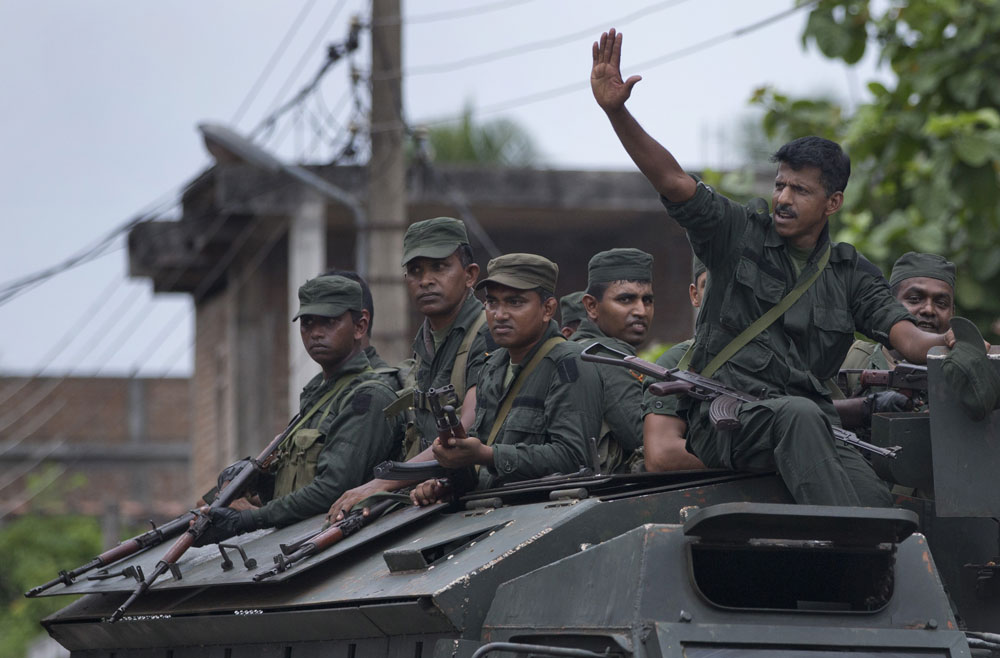 Soldiers return to their base following an operation searching for explosives and suspects tied to a local group of Islamic State militants in Kalmunai, Sri Lanka, Monday, April 29, 2019.