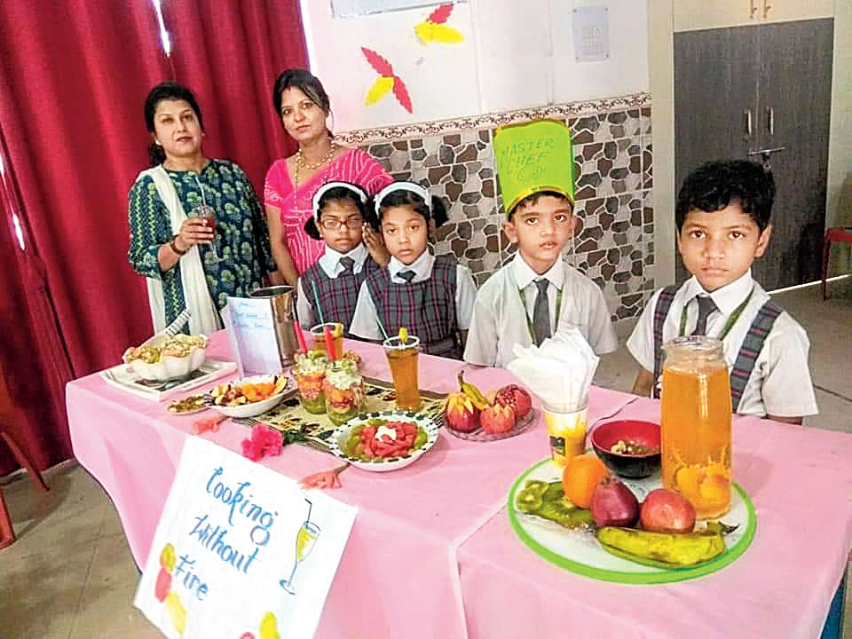 Young chefs: Students of Loyola Convent School, Booty in Ranchi, display the dishes they made as a part of their institution's 'fireless cooking' initiative recently.