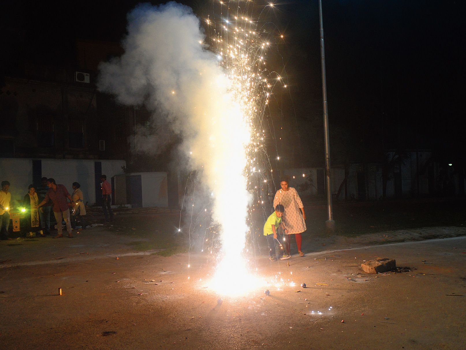 A woman and child light firecrackers in Bagbazar at 9.41pm on Tuesday.