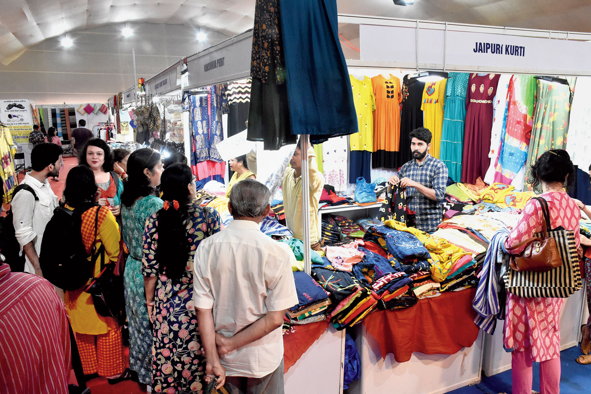 Customers crowd a stall at the Trade Fair