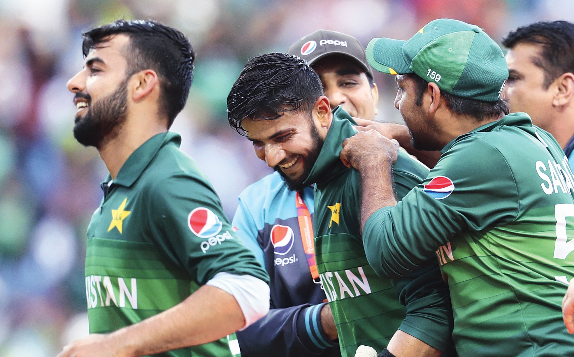 Man of the Match Imad Wasim is congratulated by Sarfaraz Ahmed and teammates after Pakistan's three-wicket victory  over Afghanistan at Headingley on Saturday.