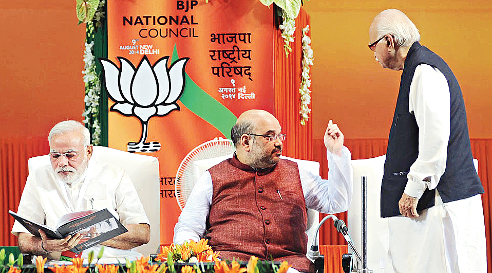 Narendra Modi, Amit Shah and L.K. Advani at a BJP National Council Meeting in New Delhi in 2014