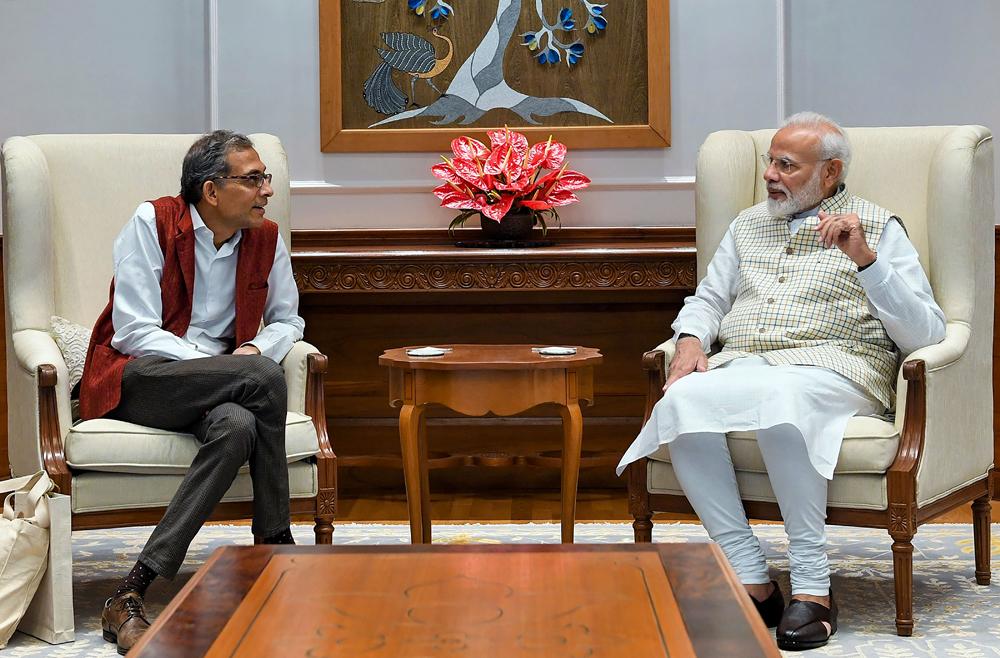 Nobel laureate Abhijit Banerjee with Prime Minister Narendra Modi in New Delhi on Tuesday