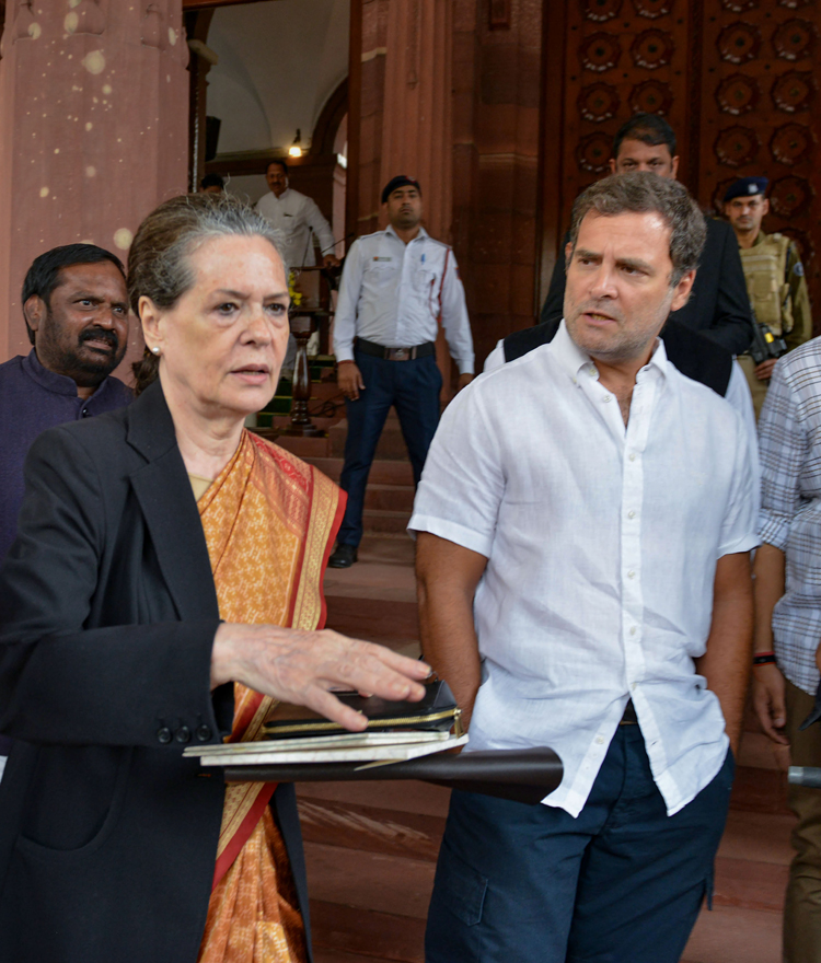 Congress leaders Sonia Gandhi and Rahul Gandhi at Parliament on Wednesday