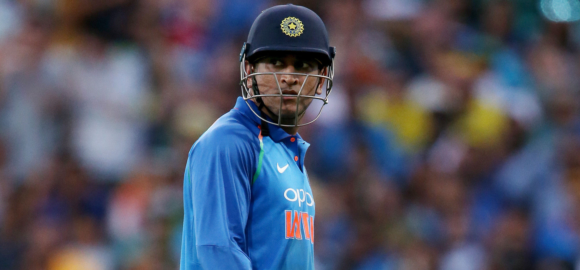 India's M.S. Dhoni walks off after losing his wicket to Australia's Jason Behrendorff during their one day international cricket match in Sydney on Saturday, January 12, 2019.