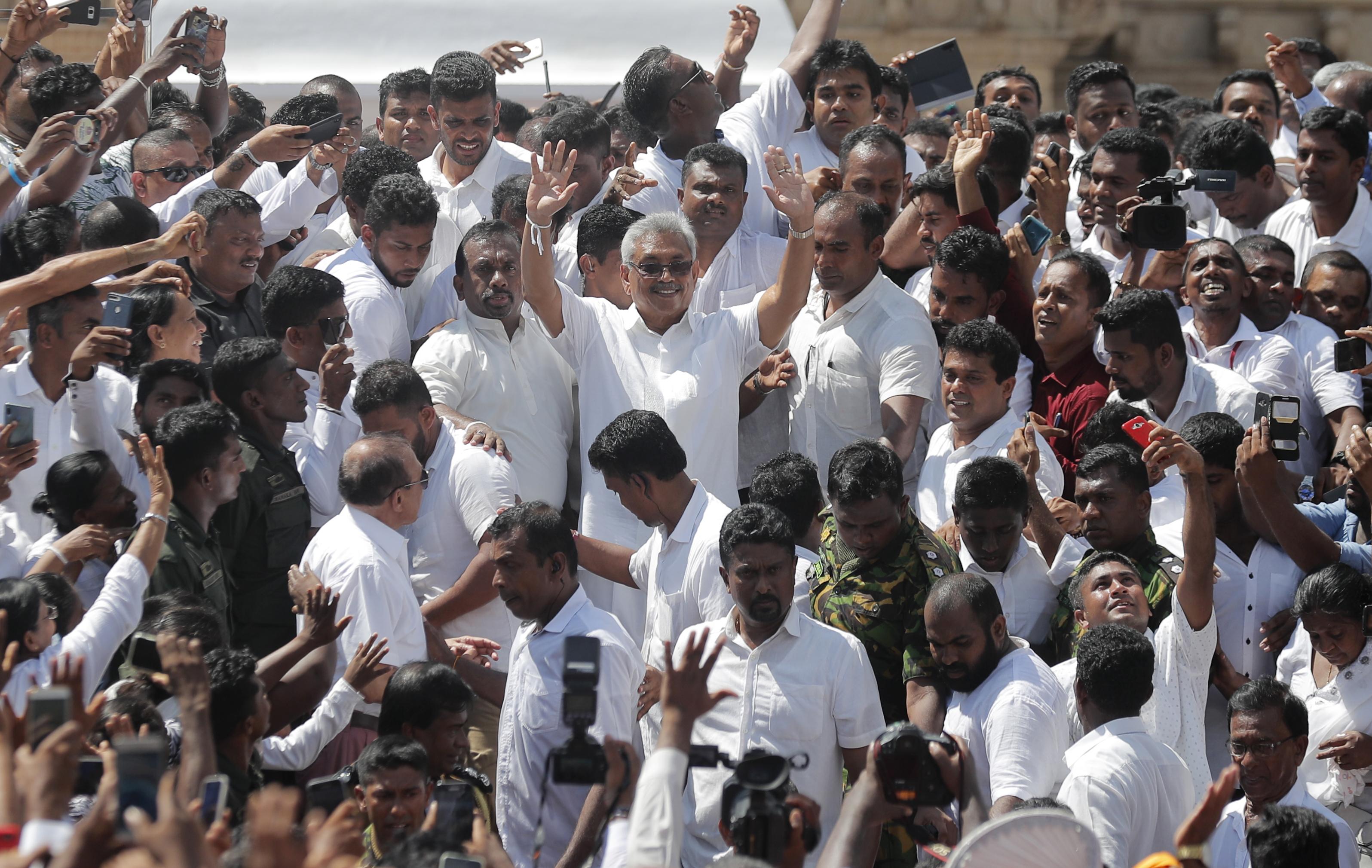 Gotabaya Rajapaksa, greets people as he leaves after the swearing in ceremony held at the 140 B.C Ruwanweli Seya Buddhist temple in ancient kingdom of Anuradhapura in north central Sri Lanka on November 18, 2019