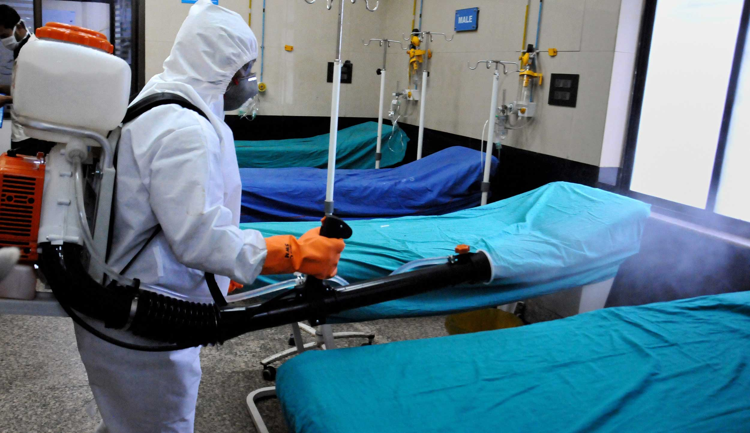 A health worker sprays disinfectant inside a hospital in Calcutta on Wednesday.