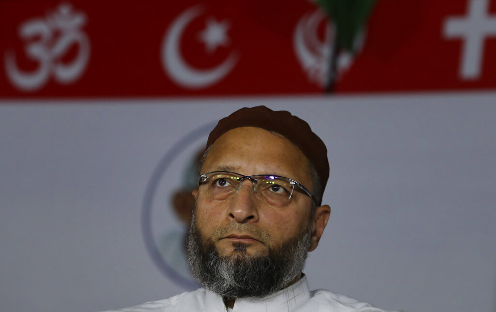 Indian lawmaker and president of the All India Majlis-e-Ittehadul Muslimeen (AIMIM) Asaduddin Owaisi listens to a speaker during a protest against a new citizenship law that opponents say threatens India's secular identity in Bangalore, on Thursday