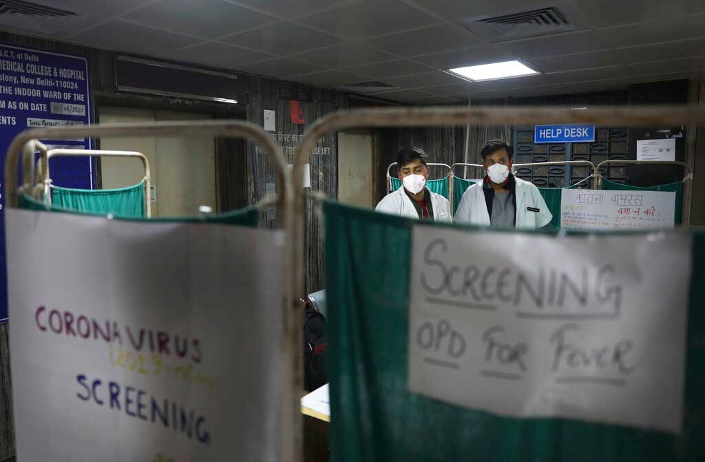 Doctors screen a patient in an isolated area set aside for suspected Covid-19 patients at a government hospital in New Delhi.
