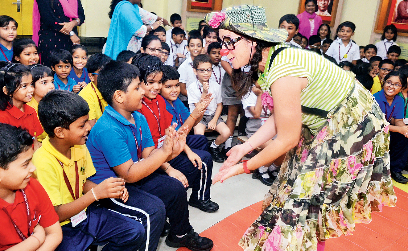 Social clown Monica Santos interacts with children at Indus Valley World School and (below) Future Hope School.