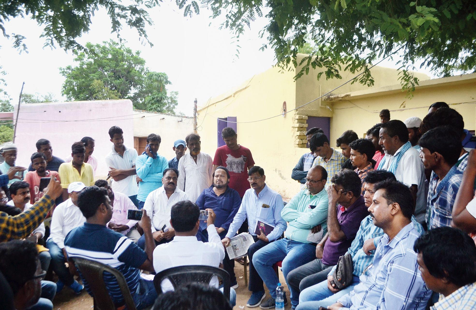 Ajsu Party members outside Tabrez Ansari's house at Kadamdih, 55km from Jamshedpur, on Saturday.
