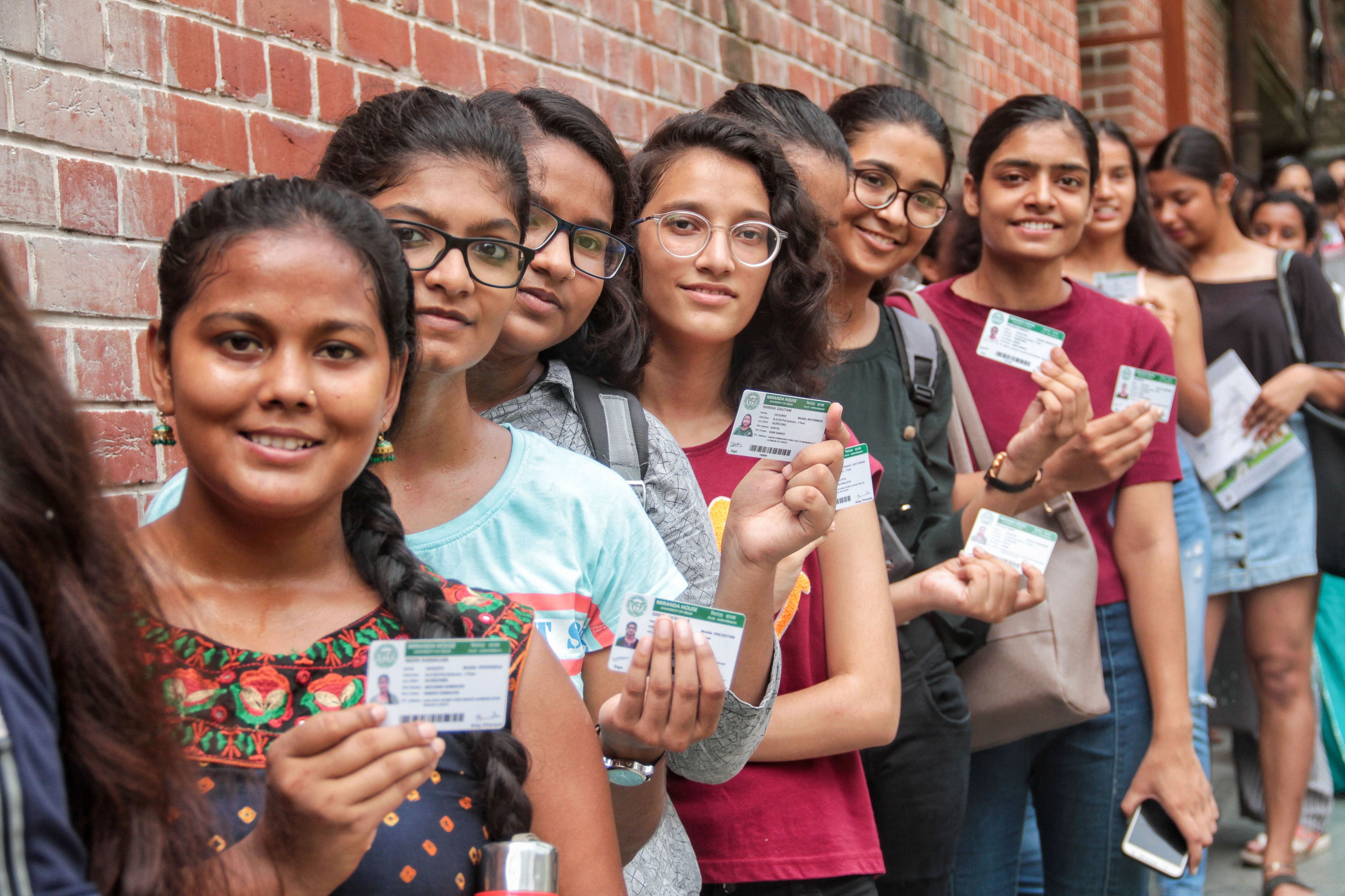 Students queue up with their identity cards to cast their votes for the Delhi University Students' Union elections, at Miranda House College in North Campus, in New Delhi, Thursday, September 12, 2019