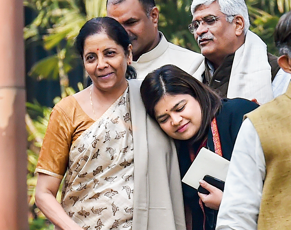 Nirmala Sitharaman and BJP MP Poonam Mahajan leave after the BJP parliamentary party meeting in New Delhi on Tuesday