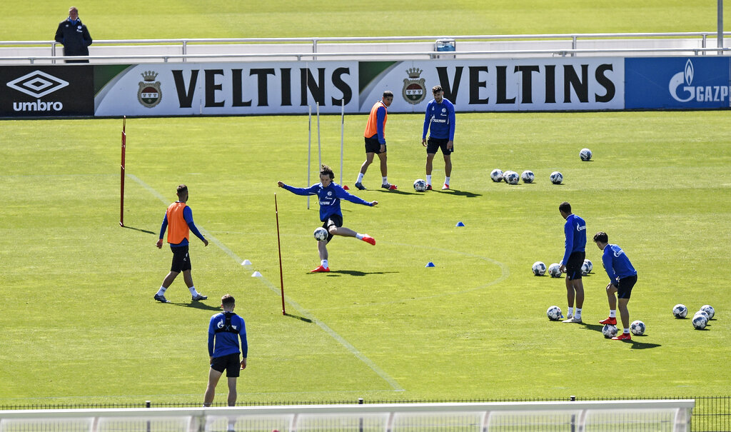 Players of Bundesliga football club Schalke 04 exercise in Gelsenkirchen, Germany on Thursday, May 14, 2020. Bundesliga will now restart on May 16, 2020 when Borussia Dortmund will play the derby against FC Schalke 04 at home without spectators due to the coronavirus outbreak.
