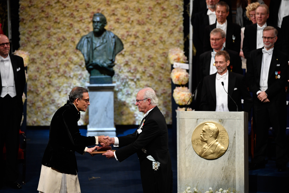 Abhijit Banerjee receives the Sveriges Riksbank Prize in Economic Sciences in Memory of Alfred Nobel from King Carl Gustaf of Sweden at the Stockholm Concert Hall on Tuesday