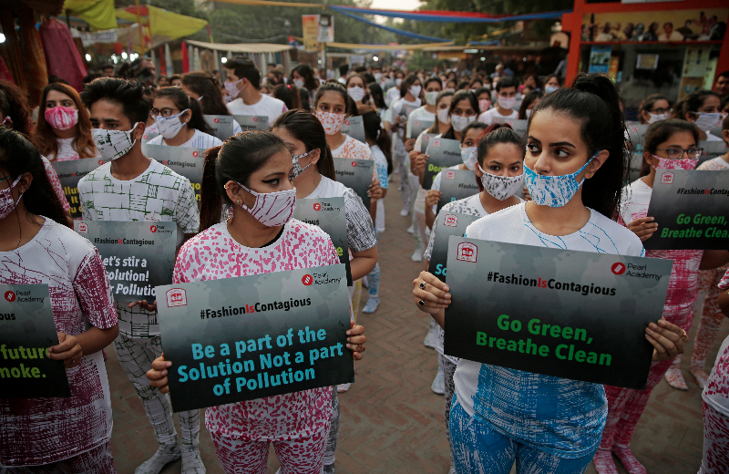 Fashion students march through a New Delhi marketplace to raise awareness about air pollution ahead of Diwali on Friday, November 2, as air quality falls to 'very severe' and the city braces itself for fireworks that may worsen it further