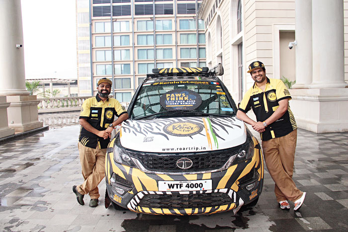 Paul (left) and Gautom with their companion for the Roar Trip, their tiger-like TATA Hexa