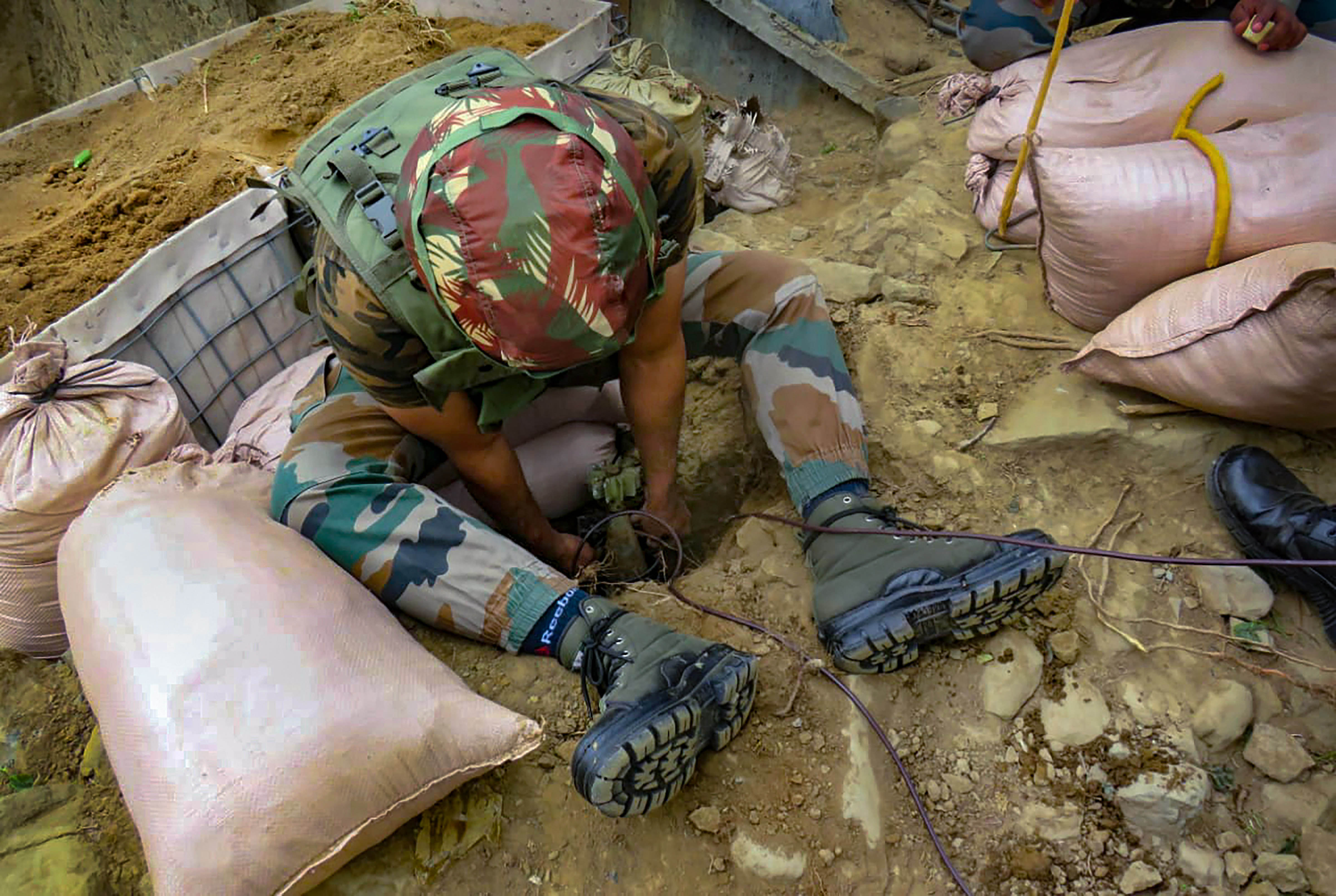 Indian army personnel during an operation to defuse mortal shells of Pakistan army in Poonch district of Jammu and Kashmir, Thursday, April 16, 2020.