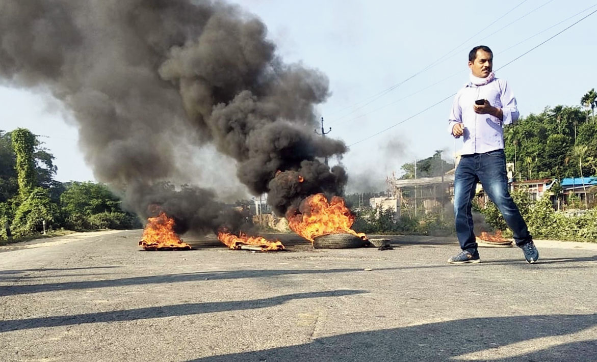 A  bandh supporter burns tyres during the 12-hour Assam bandh in Jorhat on Tuesday.