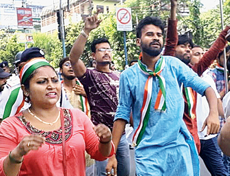 Bharatiya Janata Yuva Morcha workers hold a march at Hashmi Chowk in Siliguri on Monday hailing the Centre's decision on Kashmir.