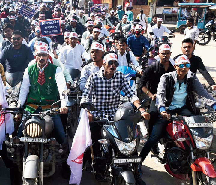 AASU activists take part in a bike rally against the bill in Nalbari on Tuesday