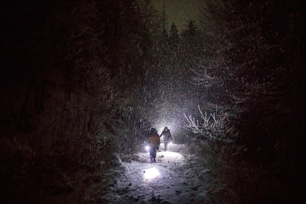 A group of Syrian refugees walk under a blizzard as they attempt to enter the EU through Croatia in the mountains surrounding the town of Bihac, northwestern Bosnia