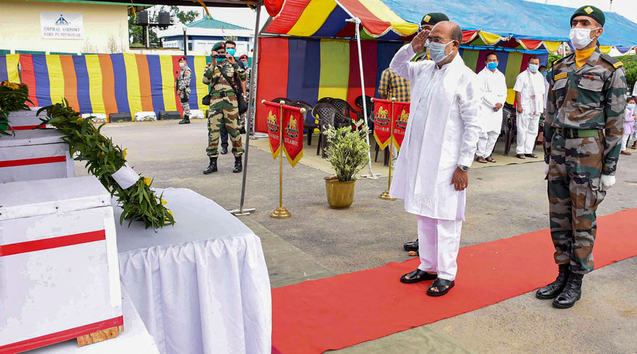 Manipur chief minister N Biren Singh pays tribute to three Assam Rifles soldiers at Bir Tikendrajit International Airport in Imphal on Friday.
