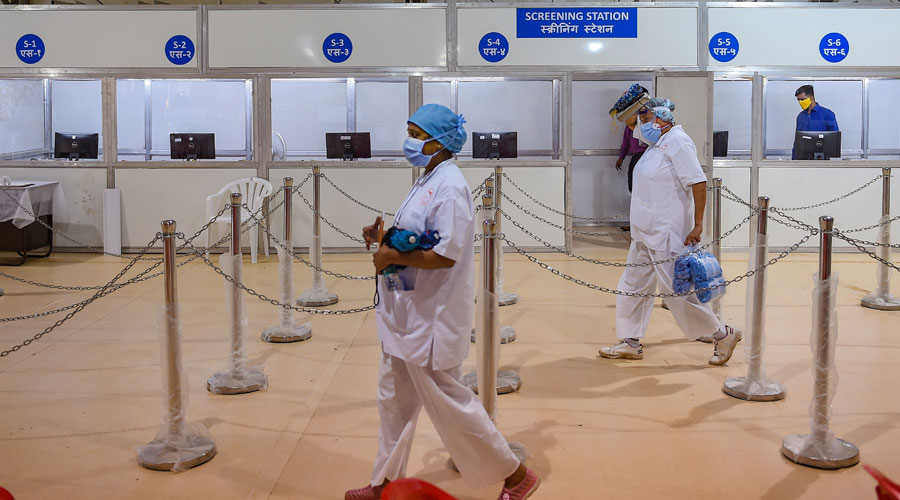 Nurses from Tata Memorial Hospital walk inside a temporary facility created to aid cancer patients diagnosed with Covid-19 in Mumbai on Thursday.