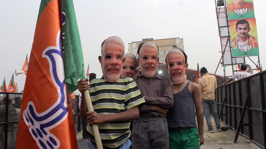 BJP supporters are seen wearing Modi masks during Lok Sabha elections, at Shastri Park on May 1, 2019 in New Delhi, India.
