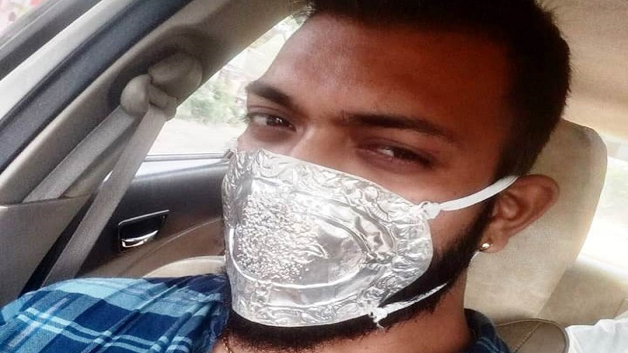 Sumit Verma with his silver mask in Hazaribagh on Saturday