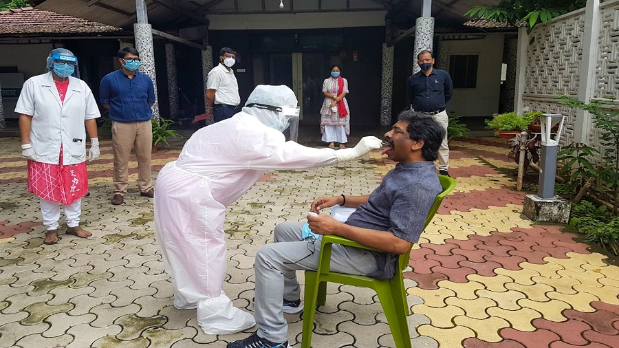 Health workers collect a swab sample from chief minister Hemant Soren at his residence in Ranchi on July 11, the first time he was tested