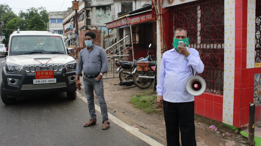 An official of the Deoghar district administration using a loud-hailer to announce lockdown norms recently.