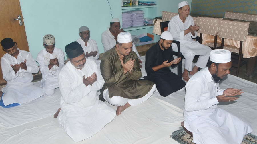 Former minister and Congress MLA Mannan Mallick (in chair), along with family members, offer namaz on the occasion of Eid on Saturday.
