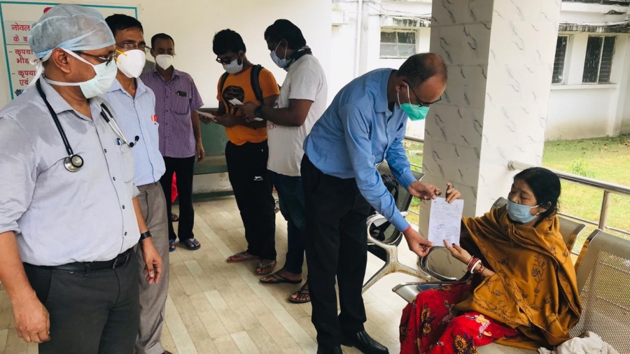 A civil surgeon giving discharge certificate to the cured coronavirus patient in Bokaro general Hospital (BGH)