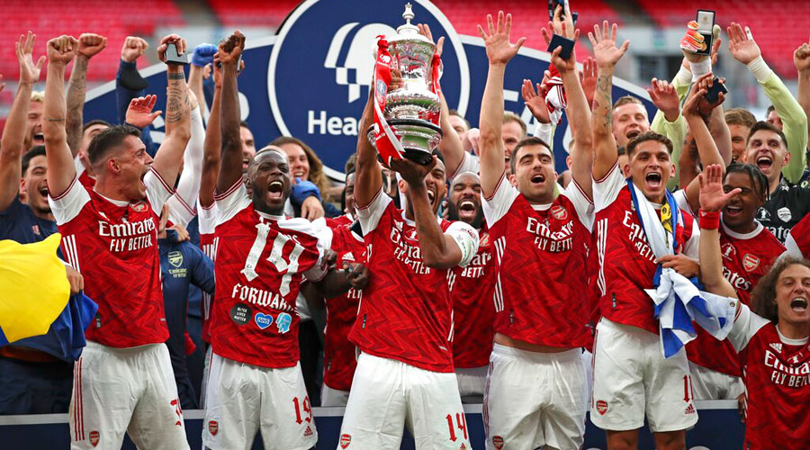 Arsenal players celebrate with the FA Cup trophy on Saturday.